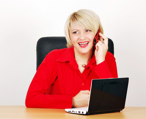 photodune-1328178-business-woman-with-phone-and-laptop-xs